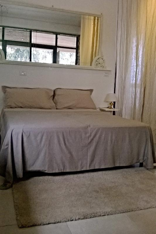 sleeping area with King size bed
