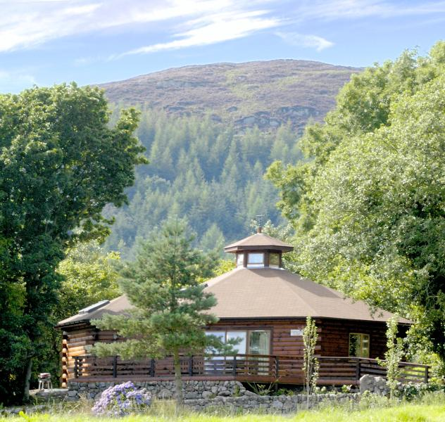 Oakwood Lodge is a unique hexagonal log cabin nestled in an ancient oak wood.