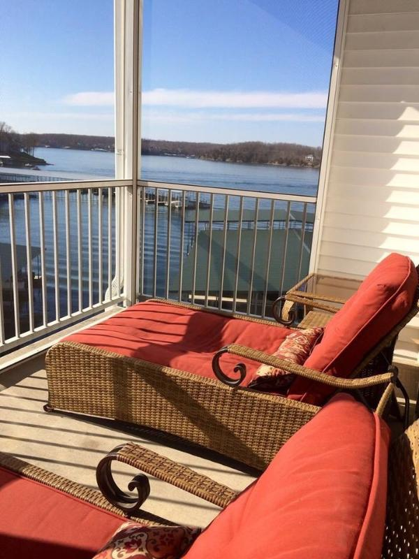 Relax in lounge chairs on the screened patio