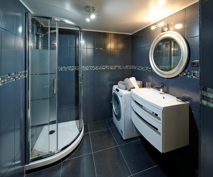 Bathroom with shower, vanity area and toilet
