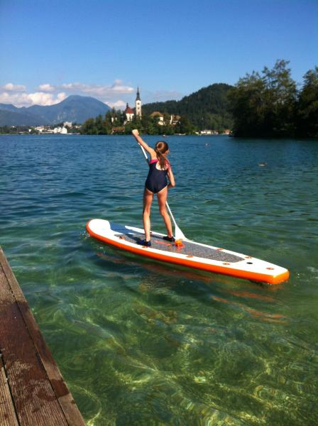 Stand up paddle boarding on Lake Bled