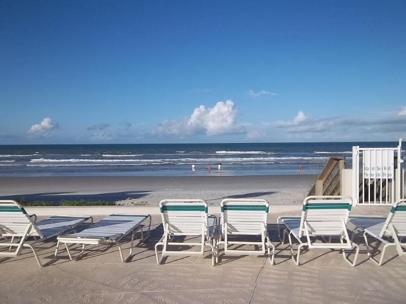 Lovely ocean and sky view from our pool deck chaise lounge chairs!!