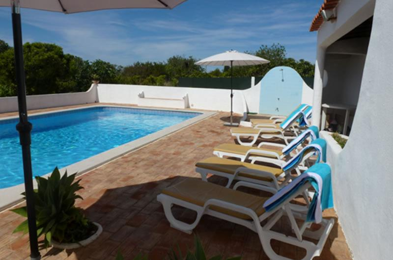 A pool terrace with 8 loungers pool towels and parasols