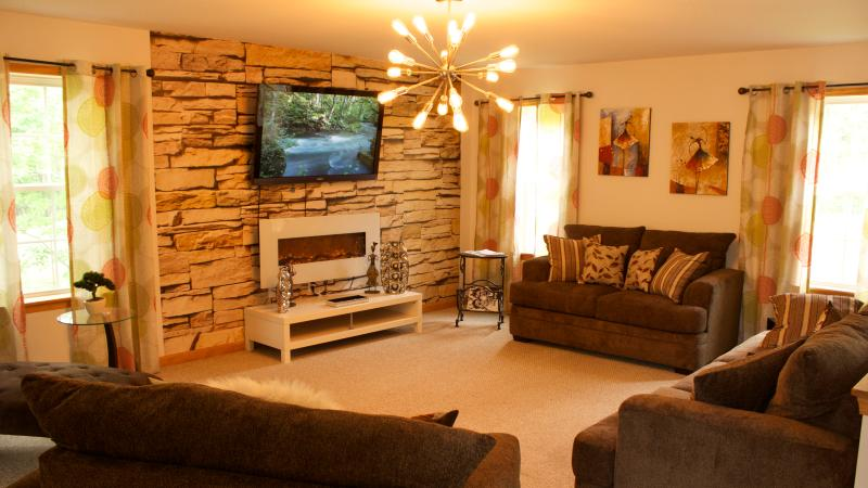 Living room, featuring 55 inch LCD + premium cable, fireplace, soft couches