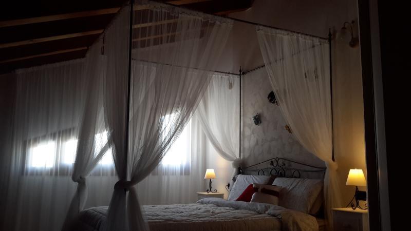 quarto principal com cama de dossel