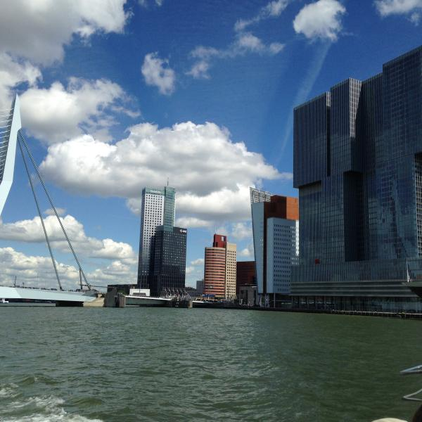 Rotterdam with the river Maas, Erasmusbridge liftside and building The Rotterdam from Koolhaas