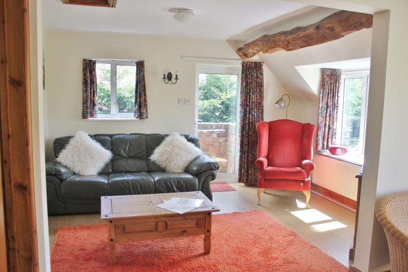 lounge with views of the gardens and the Cotswolds