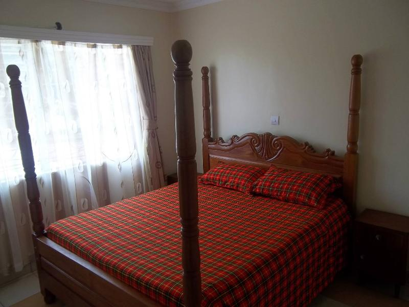 African queen size bed in master bedroom