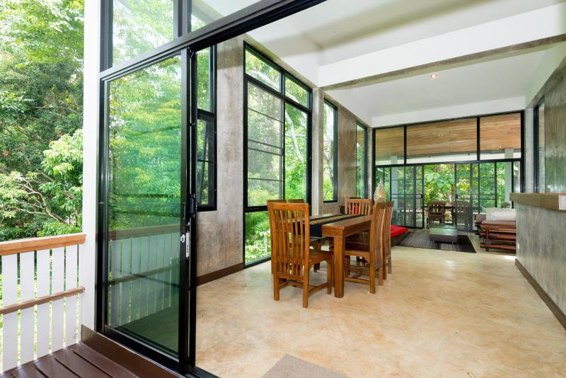 Modern, ultra clean, huge picture windows, indoor and outdoor dining areas