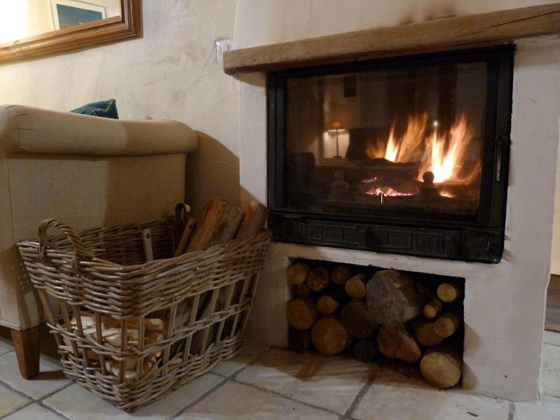 A wood stove to warm your heart - we light the fire for when you come home!