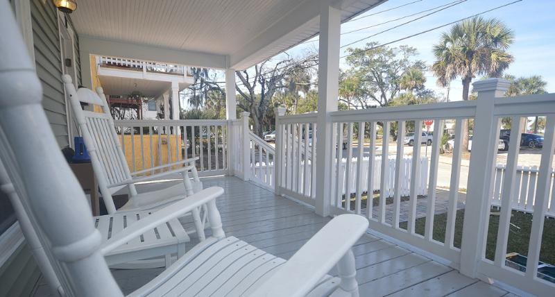 Front porch with rocking chairs. Enjoy your lemonade!