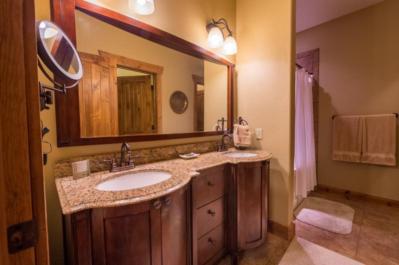 Double vanity and lighted 10x mirror-love it or hate it-you're sure to want one at your house soon.