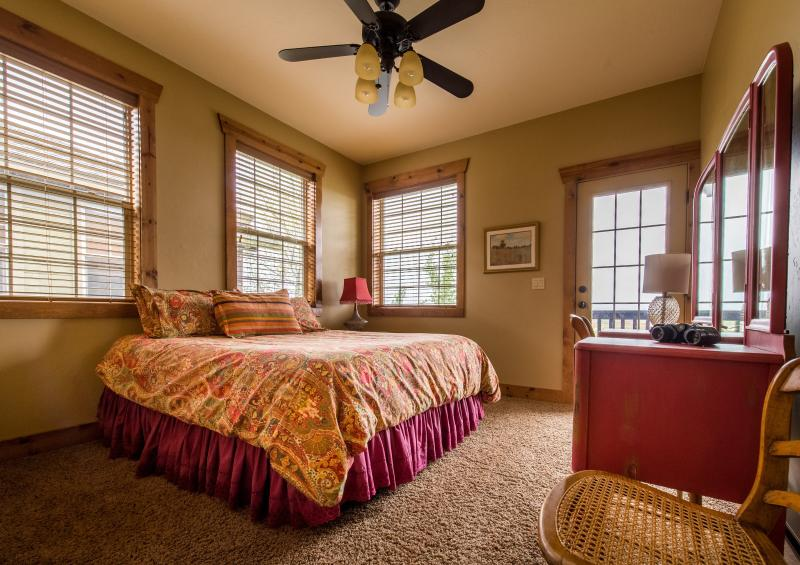 Cheery and lovely room with new memory foam queen bed and terrific down comforter/linens and balcony