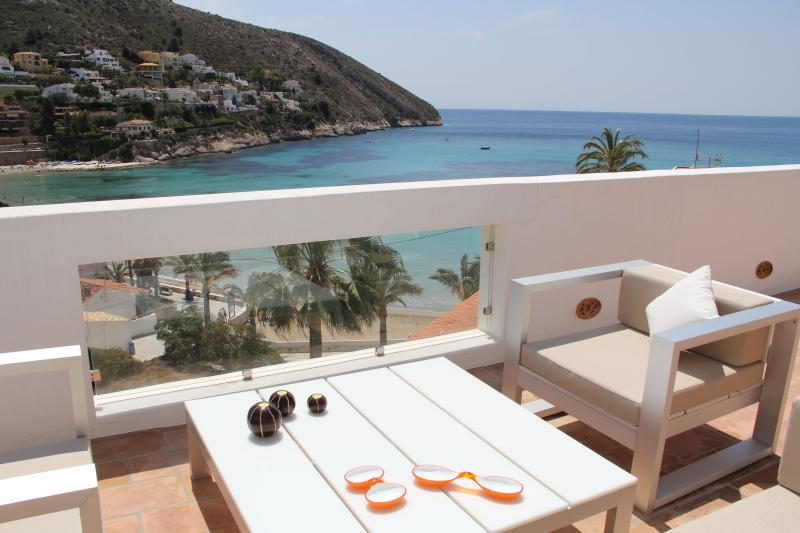 Lounge seating on Terrace with spectacular views of El Portet bay