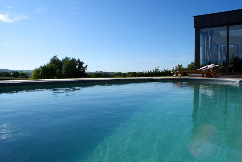 The 30°C swimming pool and it's wonderful view.