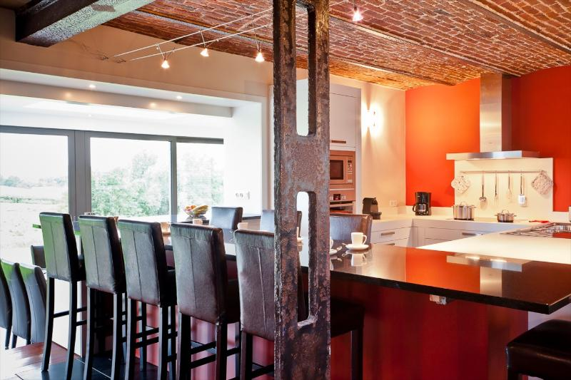 The fully equipped kitchen surrounded by a granite bar.