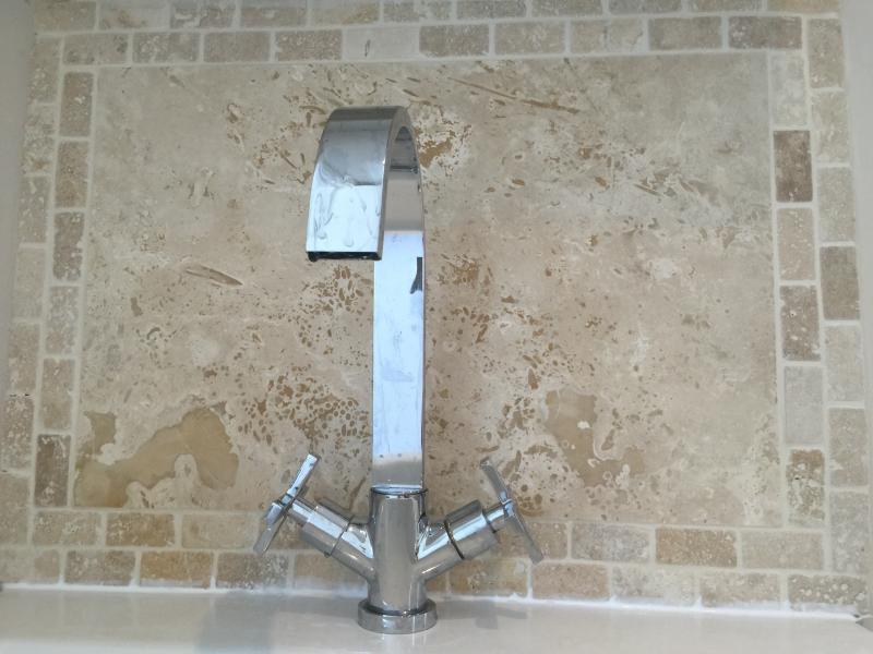 Tavertine natural stone tiles in bathrooms