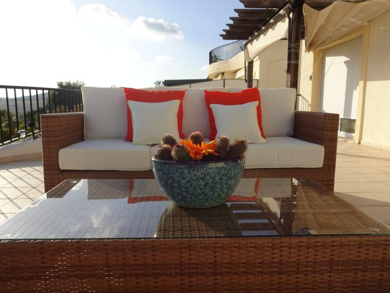 Large terrace comfortably furnished with quality furniture to enjoy a sundowner