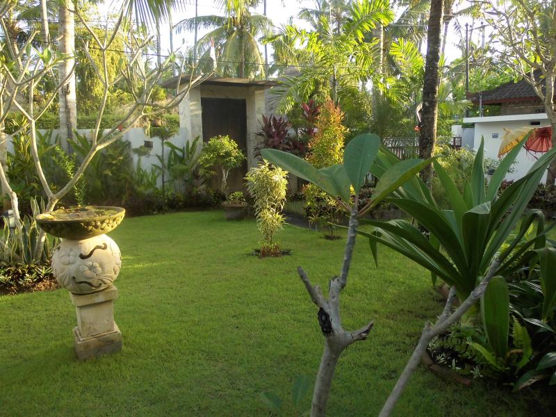 Room for a yoga mat in the garden. Close the front door and the villa is private.