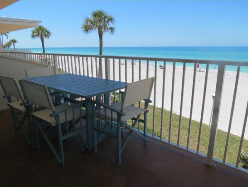 View from the balcony: miles of beach with a comfortable table for four.