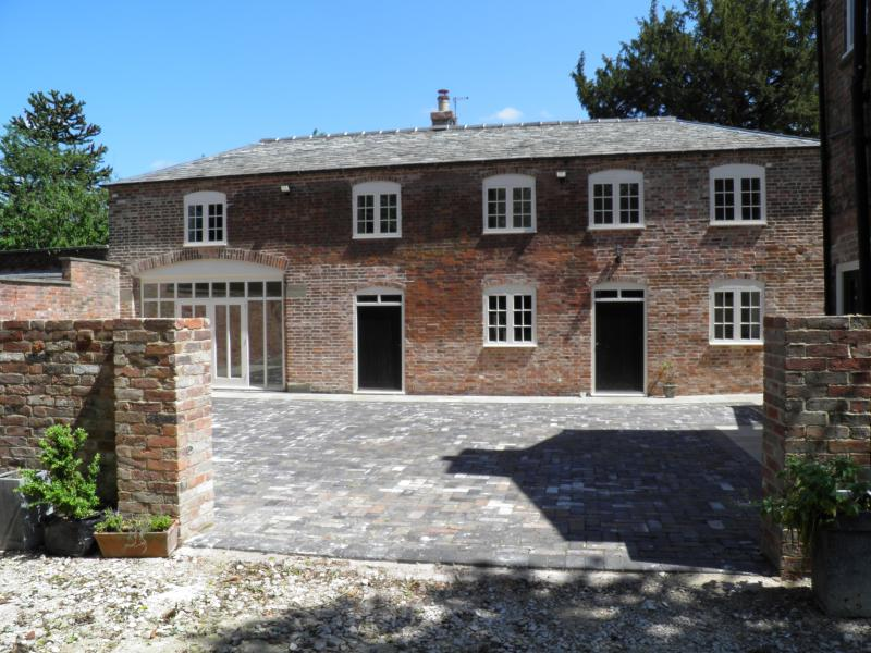 The coach house viewed from the driveway, across the courtyard