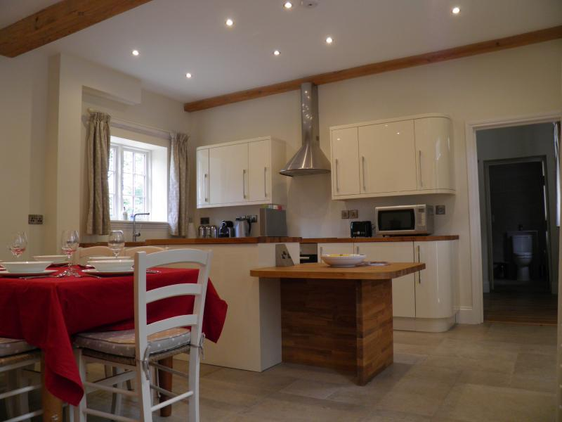 The fitted kitchen with oven, hob, microwave, dishwasher & washer dryer