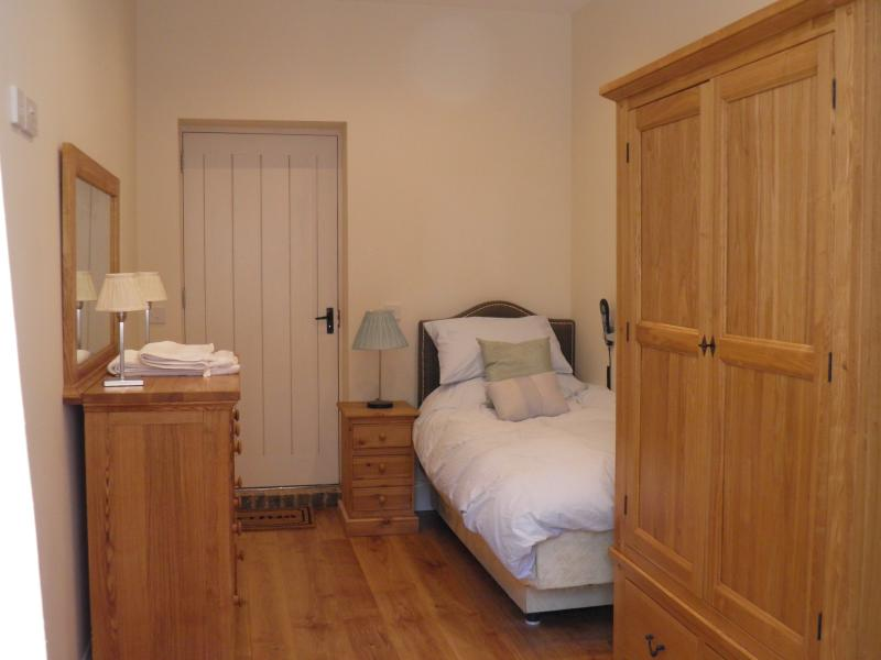 Downstairs wheelchair friendly single bedroom with en-suite wet room