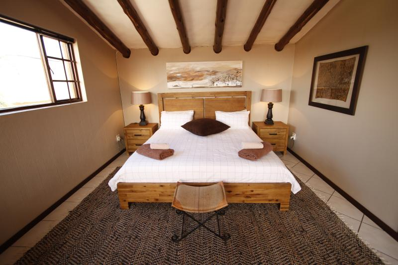 The loft room with extra length king size bed; a single bed can be added  for a child