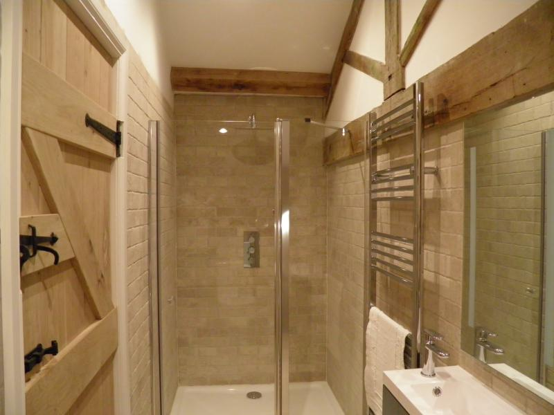 en-suite bathroom to bedroom three with a huge shower cubicle
