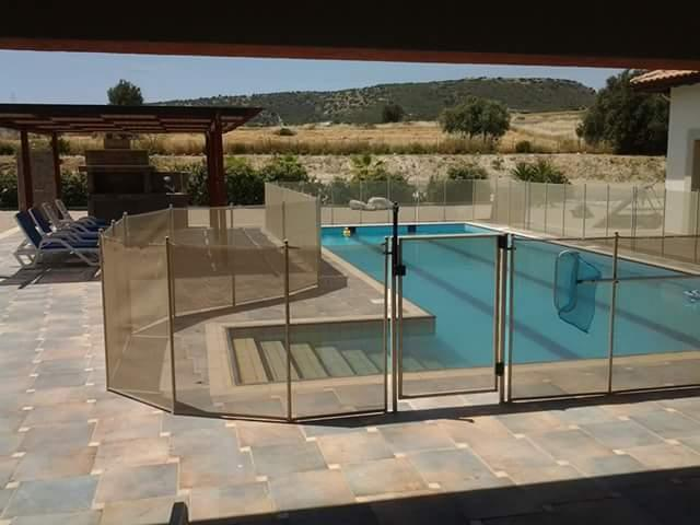 child safety fence (optional) but helps keep pool clean from surrounding private land