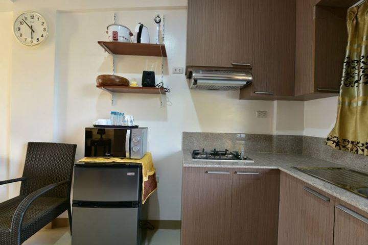 kitchen with refrigerator and microwave