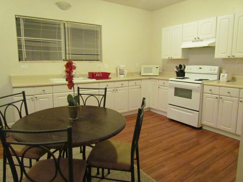 Kitchen/dining area, toaster oven, coffee maker & grinder, waffle maker, microwave, stove, fridge