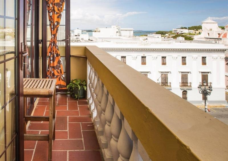 Full-size balcony with partial view of the San Juan Bay. See the cruise ships pass by.