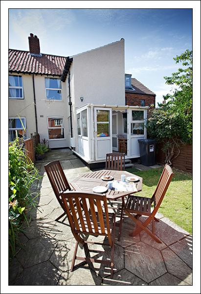 The rear garden is a sunny, and has a storage shed for bikes and fishing tackle