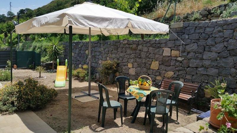 Garden entrance with dining area/relaxation: gazebo, table and chairs, games for children
