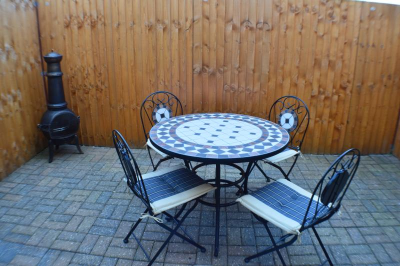Courtyard dining with chimenea barbecue for those summer evenings