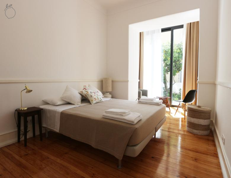 Charming master bedroom with kingsize bed and access to the backyard. Great sunny mornings.