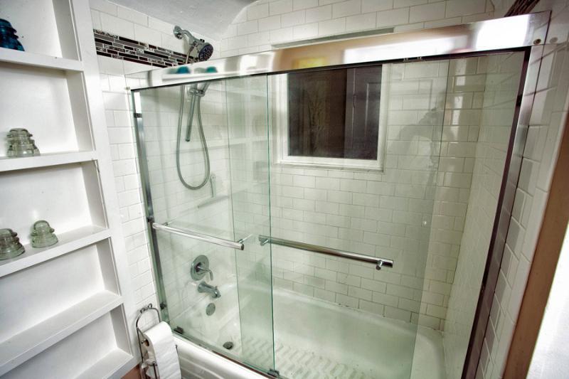 Custom tiled tub/shower and lots of storage in the main floor bathroom