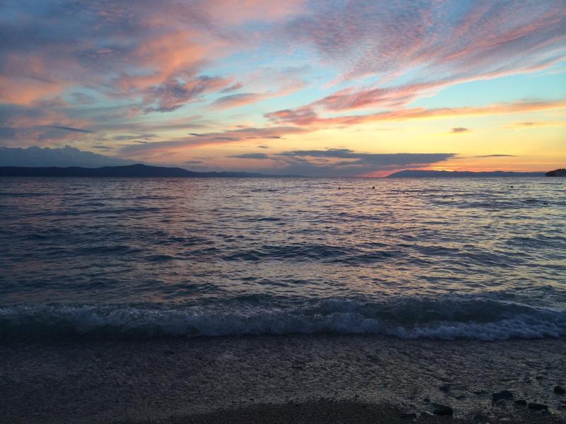 Breathtaking views of sunsets above island Brac, captured from Zivogosce beach.