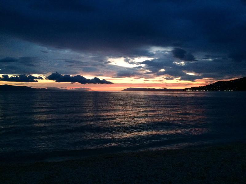 The view from the beach at nearby town of Igrane at nightfall.