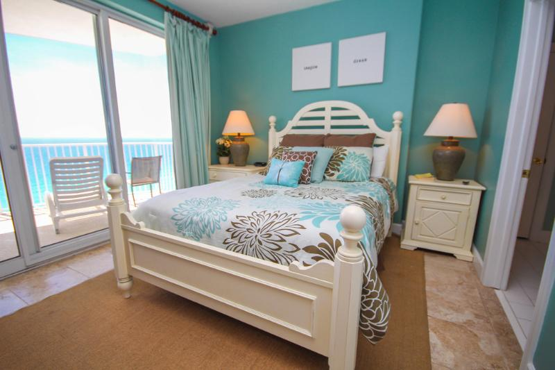 Beautifully decorated master bedroom with queen size bed