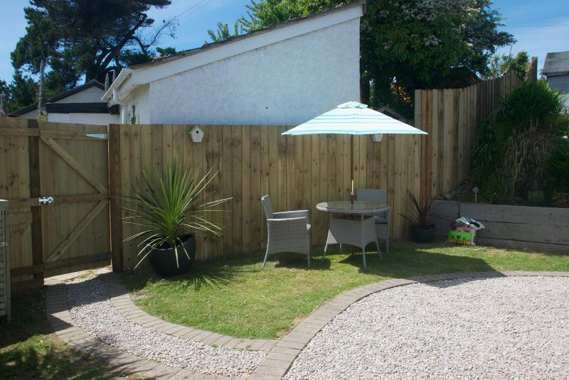View of the front garden. Private with a sunny spot for dining.