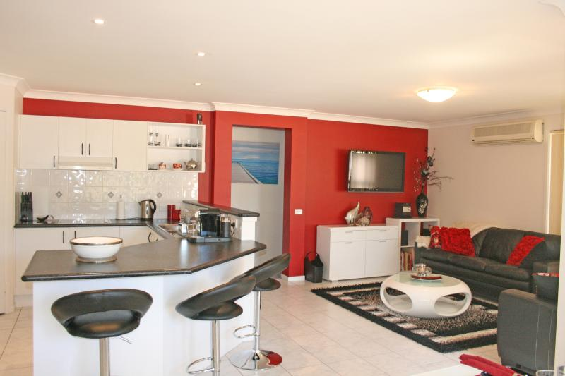 MODERN KITCHEN FULLY EQUIPPED WITH ADJACENT FAMILY ROOM