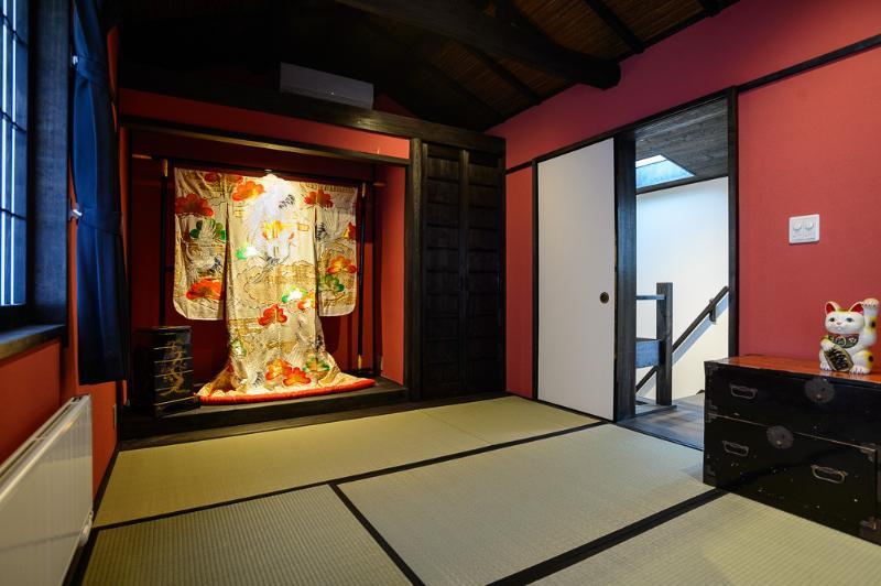 Upstairs Japanese tatami mat room, with an old traditional wedding kimono
