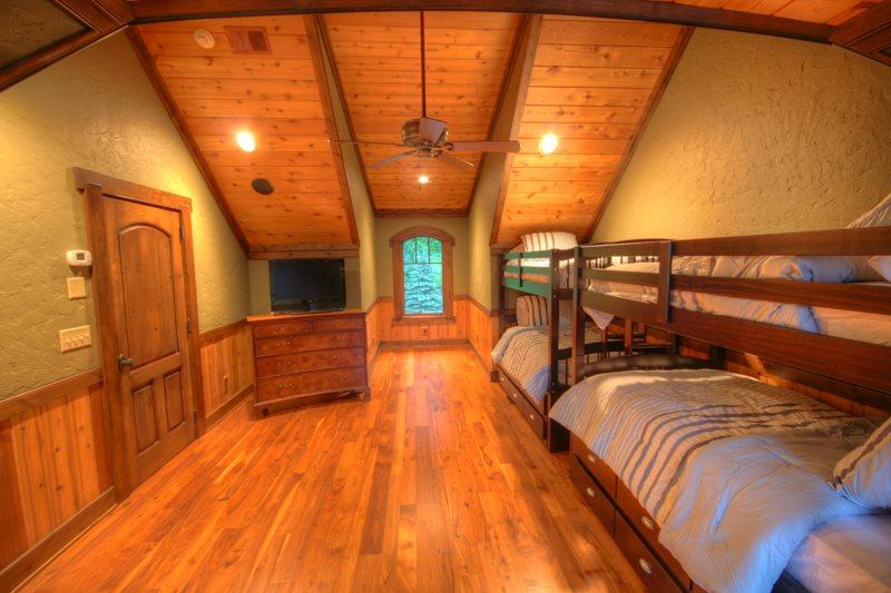 Adirondack Bunk Room with Two Sets of Bunks Plus Trundle Beds. This Room is Off the Other Side of the Upstairs Landing from the AnteRm and KingBR.