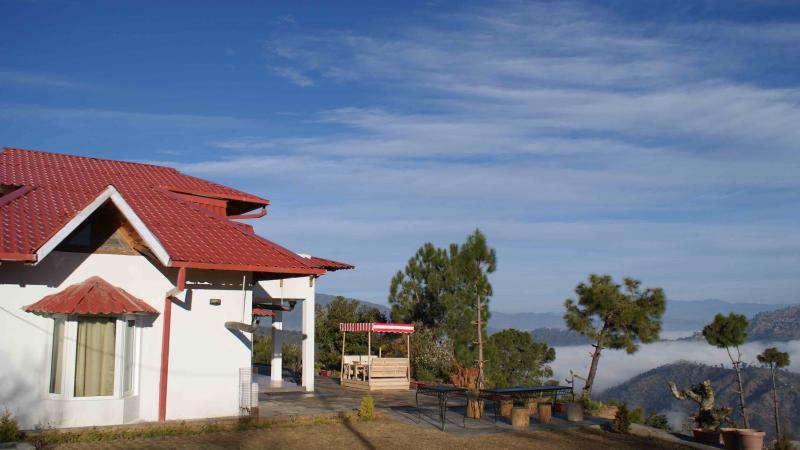 Zijaanzicht van Machus Cottage