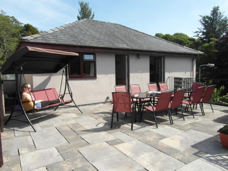 Sun terrace with swing sofa looking east