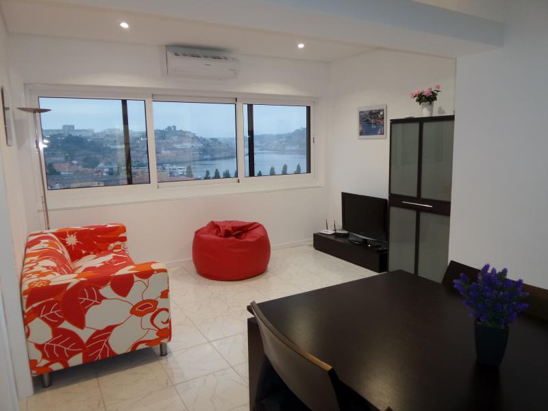 Living room with big windows to see Porto