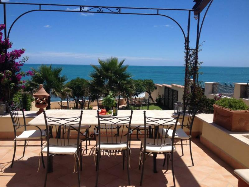 Front terrace at the 1 st floor with view over the garden and the mediterranean sea.