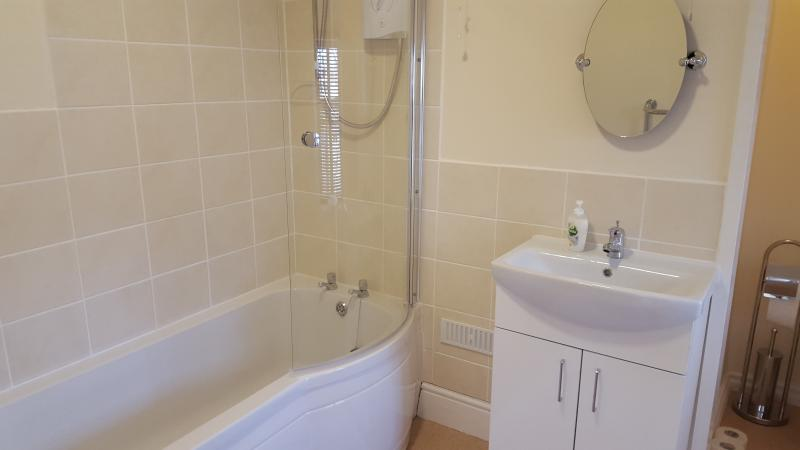 Modern Bathroom with Shower, Sink & Toilet, Towel Rail